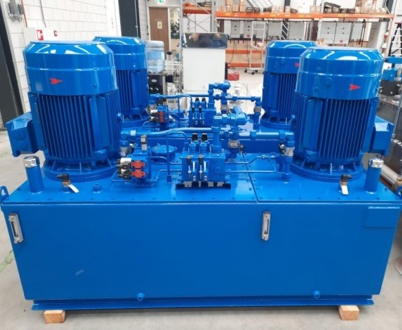 Several freshly coated hydraulic power units (HPU's) ready for shipping